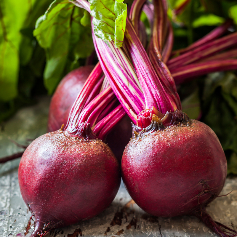 Red Beets with leaves on the counter